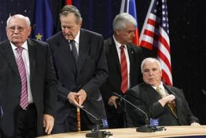 Former Soviet Union President Mikhail Gorbachev (L), former U.S. President George Bush (2nd L) and former German Chancellor Helmut Kohl (R) attend a ceremony of the Konrad-Adenauer foundation to mark the upcoming 20-year anniversary, in November, of the fall of the wall which once divided communist East Berlin from capitalist west Berlin, in Berlin October 31, 2009.        REUTERS/Fabrizio Bensch