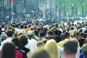 Crowd of people walking on city