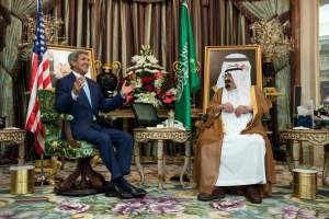 Saudi King Abdullah bin Abdul Aziz al-Saud (R) listens to U.S. Secretary of State John Kerry before a meeting at the Royal Palace in Jeddah September 11, 2014. The United States signed up Arab allies on Thursday to a