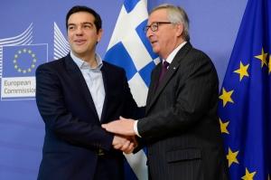 Handshake between Alexis Tsipras, on the left, and Jean-Claude Juncker
