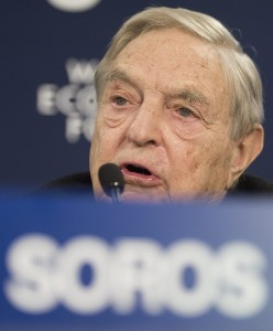 George Soros, chairman of Soros Fund Management, speaks during a press conference on the first day of the 43rd Annual Meeting of the World Economic Forum, WEF, in Davos, Switzerland, Wednesday, Jan. 23, 2013. ( AP Photo/Keystone/Jean-Christophe Bott)